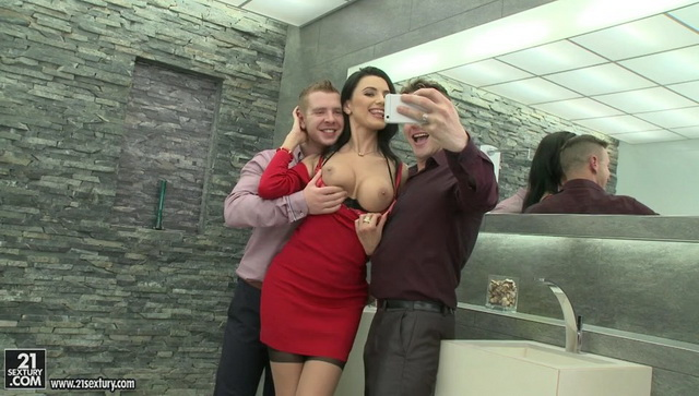 Hot Ania Kinski wears a sexy red dress and two-tone nylons ready to get team-fucked in a threesome