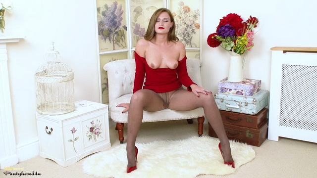 Honour May in ripped pantyhose plays with a dildo