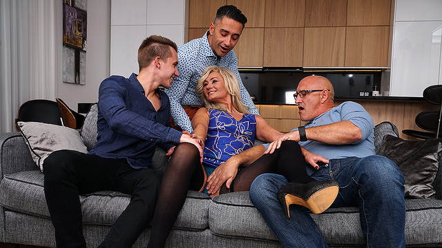 Hairy UK mature Ellen B. ties her hubby before launching into a stockinged orgy