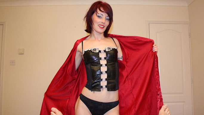 Corseted and stockinged UK redhead punishes and strokes a lame dick