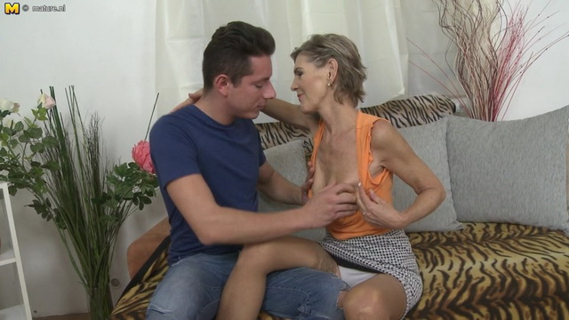 Horny mature Irenka S. peels off her white bra and panties to get fucked between her stockinged legs