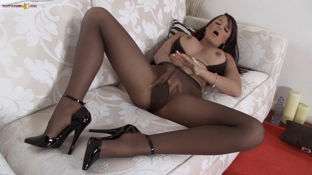 Beautiful British brunette Sasha Cane masturbates in pantyhose and high heels