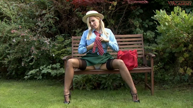 Busty British milf Michelle Thorne in school uniform masturbating outdoors