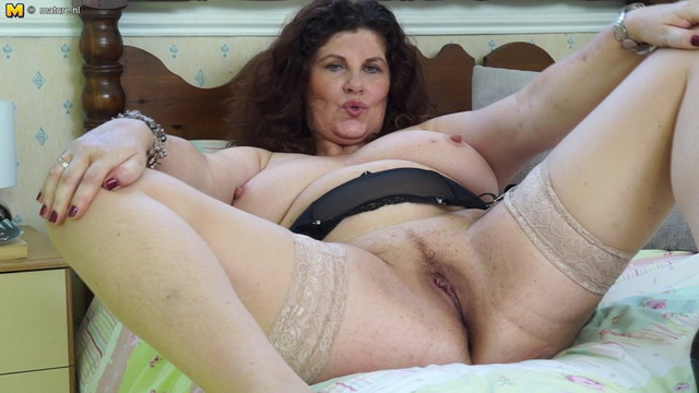 Curvy British mature Gilly Sampson playing with her wet pussy
