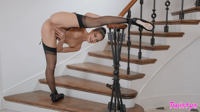 Gorgeous Emily Willis plays in her fancy black lingerie, stockings and pointes