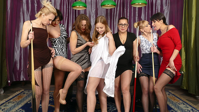 Seven ladies strip to panties and nylons for a cross-generation sapphic fuck-fest in a billiard room