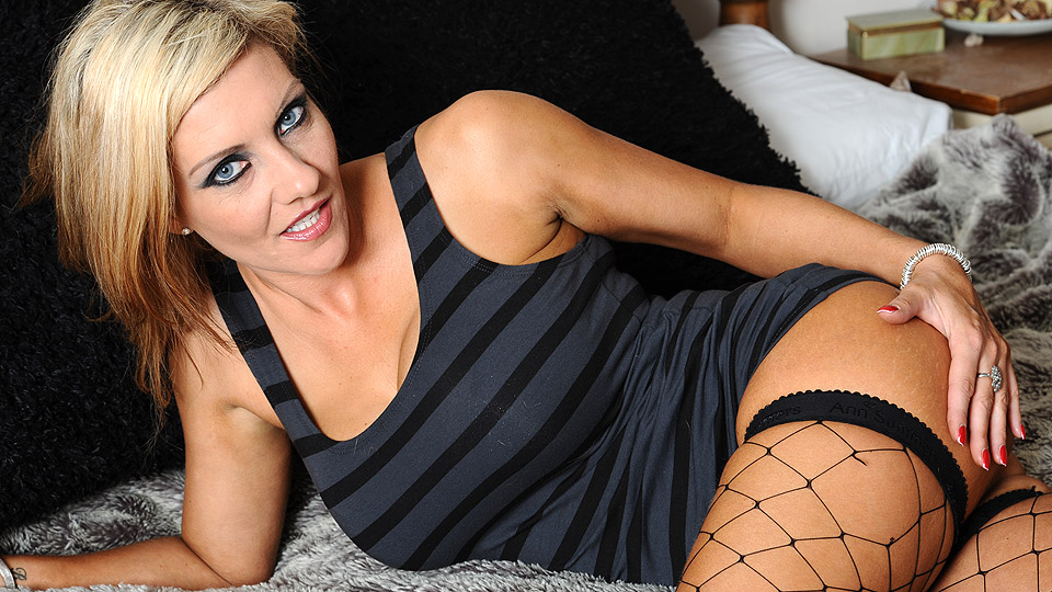 Hot british MILF Alyson McKenzie in sexy black lingerie and fishnet stockings