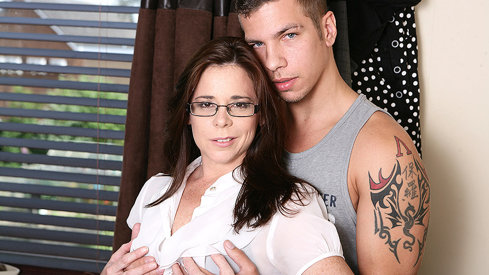 Nerdy British milf in glasses strips to her black undies and suspender nylons for a fuck
