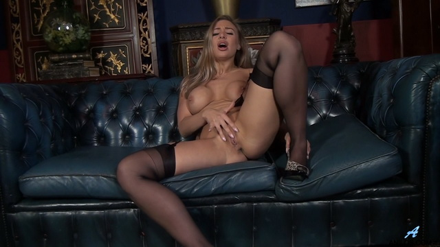 Bigtitted British mature babe Beth Bennett rubs her clit parting stockinged legs on the leather sofa