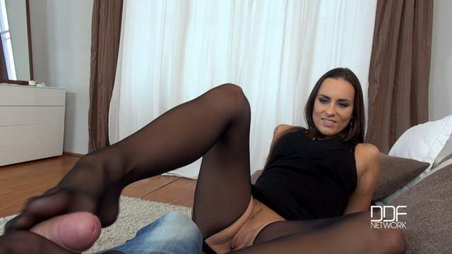 Hot Czech babe Mea Melone gives a footjob in her open crotch suspender tights and gets cummy feet