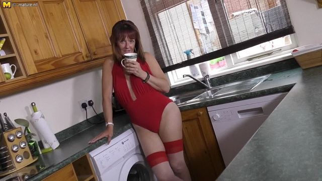British housewife Pandora playing in her kitchen