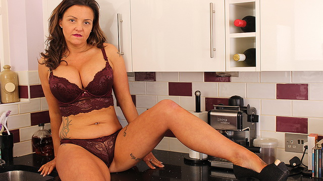 Buxom UK housewife Sienna Hudson gets dirty in the kitchen in her wine-colored lacy lingerie set