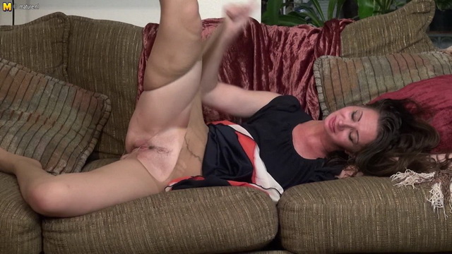 Naughty American mom in pantyhose Mia playing on the couch