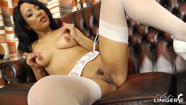 British ebony babe Kayla Louise spreads legs in her pure white set, stockings, garters and pumps