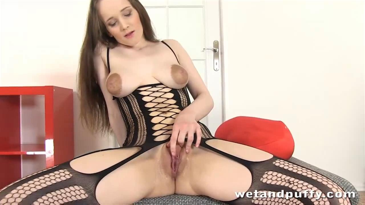 Sexy girl in bodystocking spreading pussy