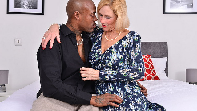 Horny mom Molly Maracas goes interracial in red-trim lingerie, stockings & heels
