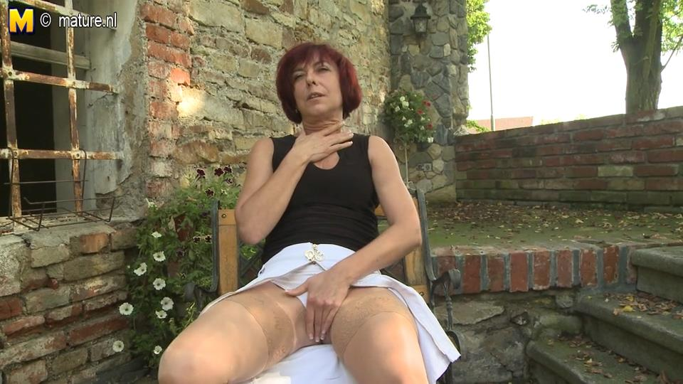 Naughty red-haired milf in suntan lace top nylons pleasuring herself at the backyard
