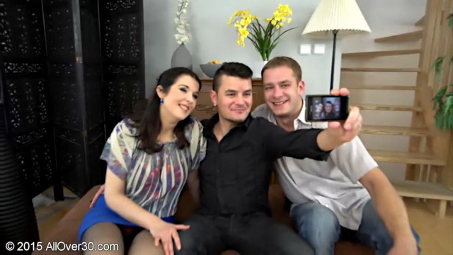Mature Fernanda Jerson and two younger guys make a selfie before a stockinged spit-roasting 3some