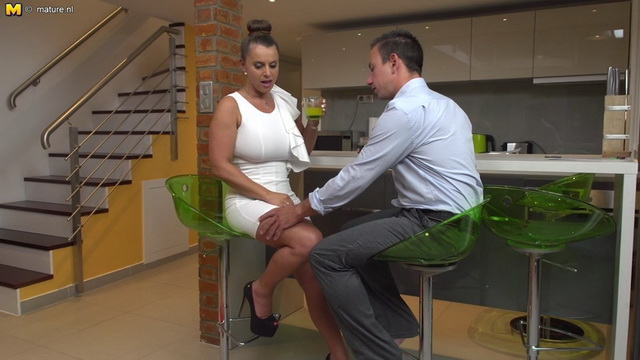Corseted German mature bombshell Susi opens her slim legs in platform heels for a kitchen quickie