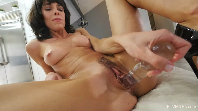 Pantyless milf Lexi Foxy showcases her tits and cracks before using various toys