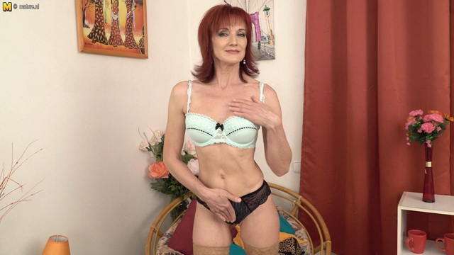 Redhead cougar Irena playing with her wet pussy