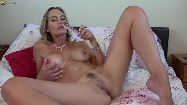 Hot UK mom Elegant Eve shows the tops of her black holdups before nude toy play
