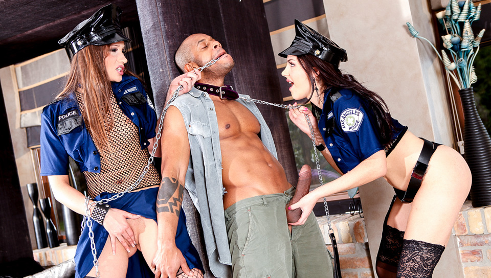 Stockinged femdoms dressed like cops discipline their brown slave