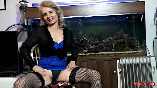 Aging lady Isabella B opens fishnet-clad legs and peels off her tiny thong to play with her wet cunt