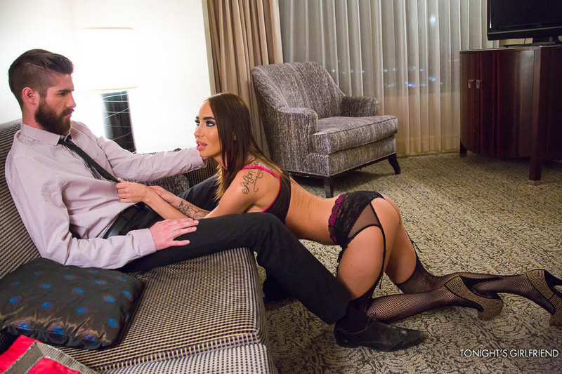 Hot fishnet clad porn babe Sandee Westgate plays a submissive for a wealthy guy