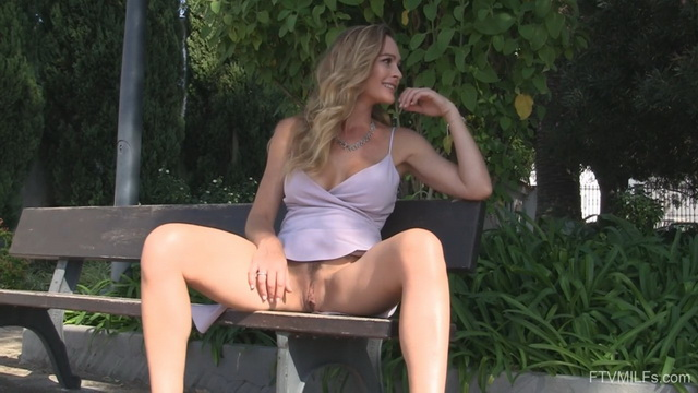 Busty UK milf Elegant Eve gets to pantyless upskirt tease parting legs in public