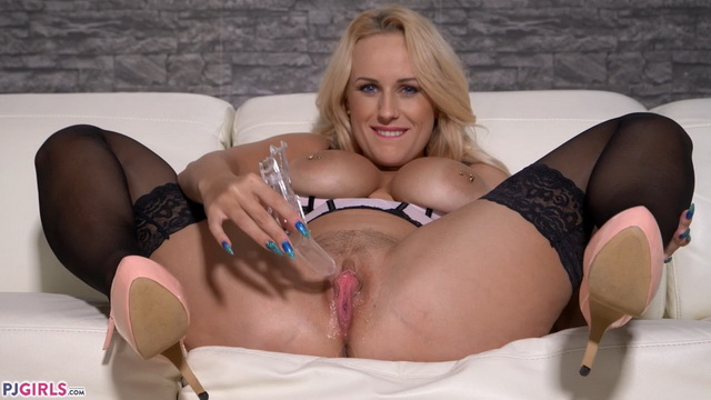 Busty blonde Angel Wicky in a pink corset and black nylons plays with a speculum