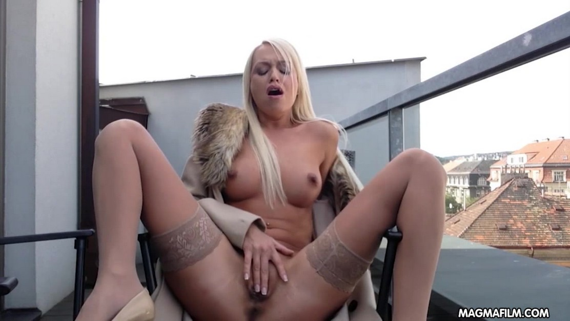 Blonde Lena Love rubs her wet pussy at the roof top patio spreading legs in nude holdups