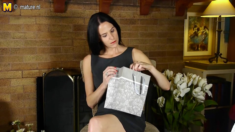 Brunette US milf Natasha gets hot and horny trying on her new black pantyhose to match her LBD