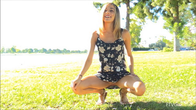Averie Moore runs nude and does upskirt cartwheels in the park in her floral dress and flat sandals