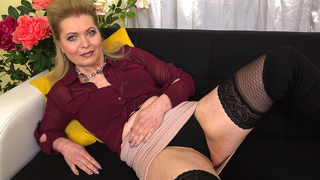Mature Mirka J. puts on a strip show before launching into stockinged solo play