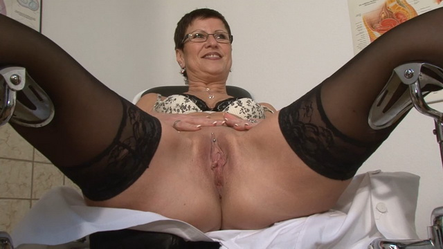 German mature doctor in stockings masturbates on a gynecological examination chair