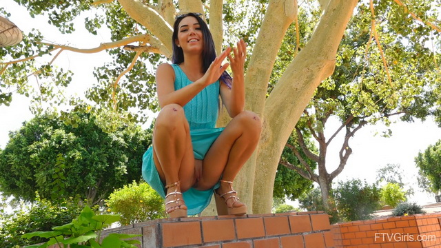 Flirty Sasha gets to pantyless upskirt tease outdoors spreading high-heeled legs