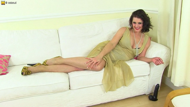 Dolled-up British milf Karina Currie ready for a toy party in her sheer nylons