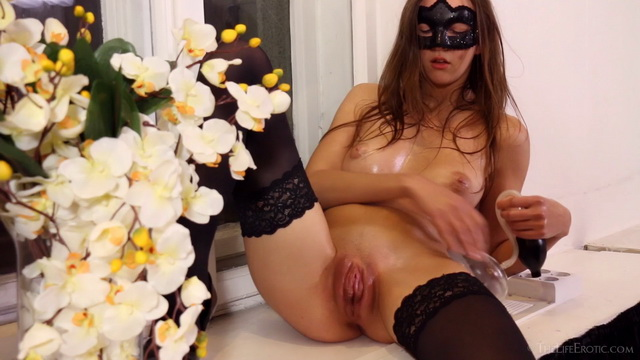 Masked Rebeka Ruby rubs oiled boobs and spreads in stockings by the window ready to use a pussy pump