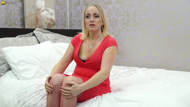 Red hot UK milf Melissa rubs it off out of her fiery dress, fishnets and pumps