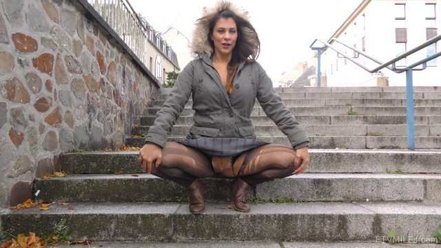 Upskirt mature Brit Roxy Mendez flashes her cleavage and rips open dark tights in cold windy autumn