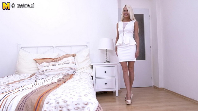 Slim-legged platinum blonde Lena Love dressed in all white strips to her lingerie showing sexy feet