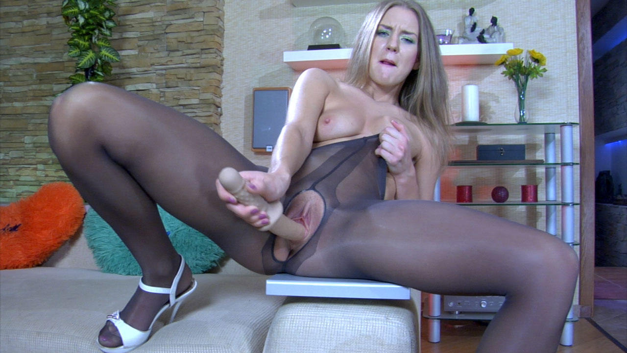 Leggy babe putting to use her hidden in crotchless tights dildo