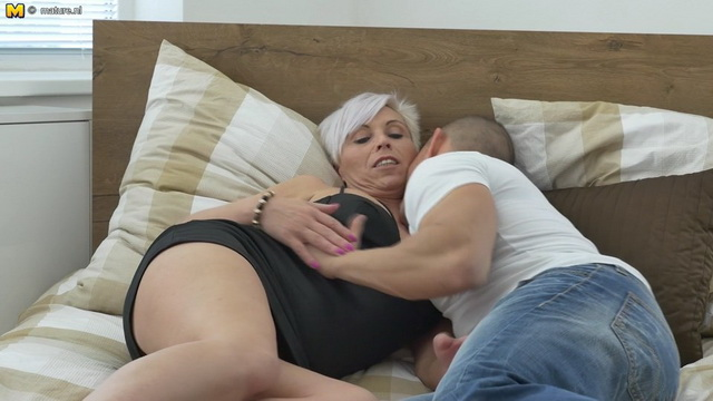 Dressy mom Kathy White gets down with her younger lover stripping to her panties and stiletto heels