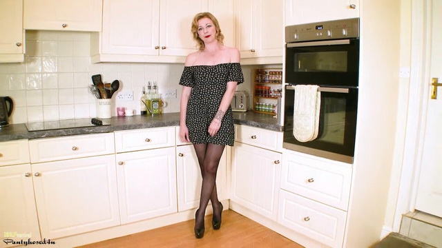 Hot UK milf Lucy Lauren parts legs in sexy tights and stilettos for kitchen play