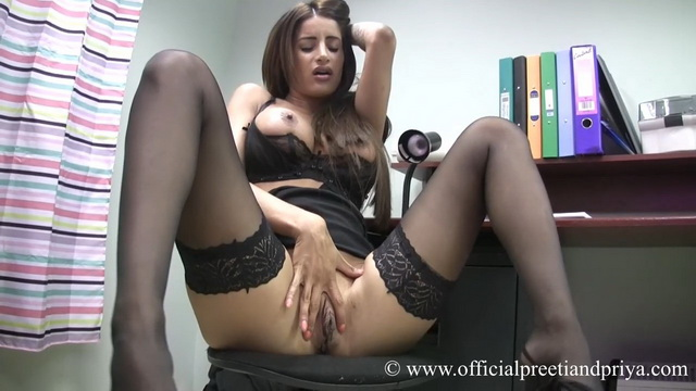 Bigtitted Preeti shows off her sexy bra and holdups spreading legs in the office