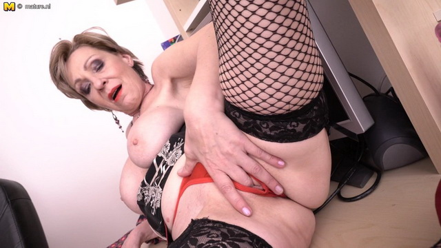 Naughty mature lady masturbating behind her computer