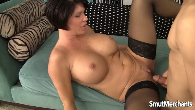 Voluptuous big-breasted lady Shay Fox parts stocking-clad legs ready to suck, fuck and gulp a load