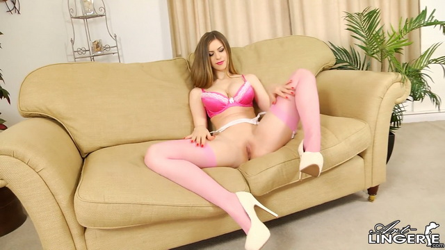 Busty slim-legged Stella Cox showcases her pink lingerie with matching stockings