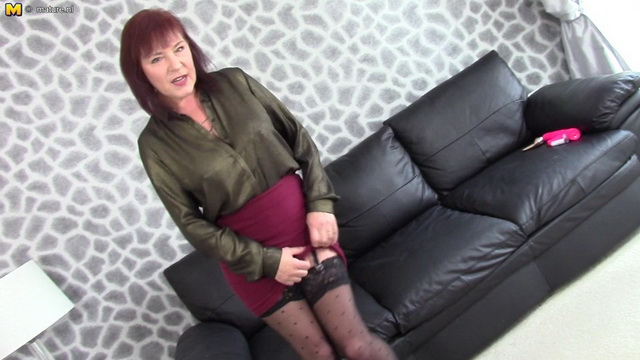 English mature Wendy Taylor in dotted stockings and metal heel pumps plays with her boobs and pussy